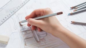 Person drawing architectural plans