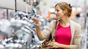 Woman looking at taps in shop
